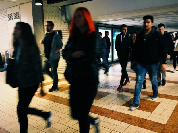 Red-haired girl rushing by